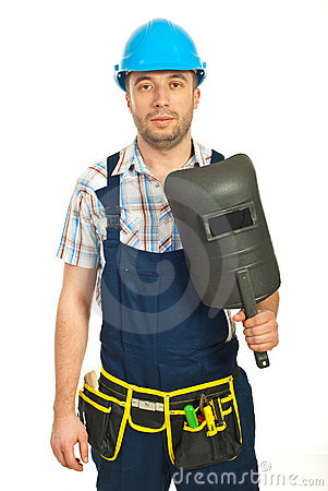 Workman holding welding mask