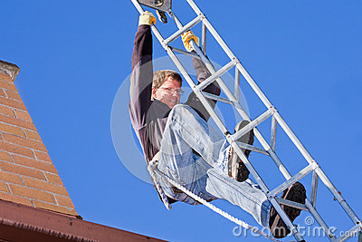 Workman installing HDTV digital antenna