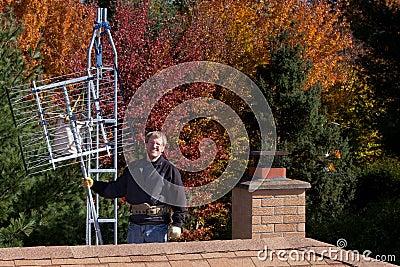 Workman installing HDTV digital antenna