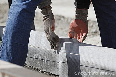 Workman laying bricks