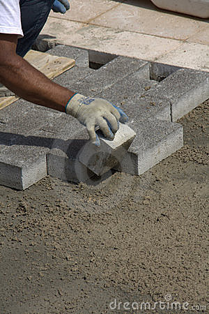 Workman laying sidewalk