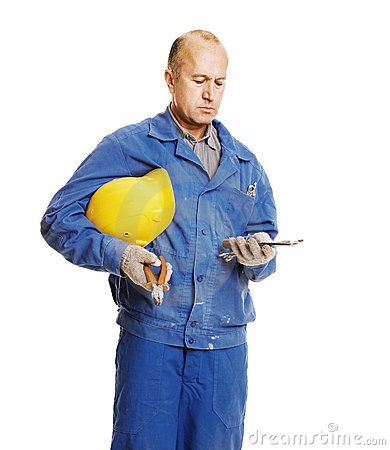 Workman looking at tools