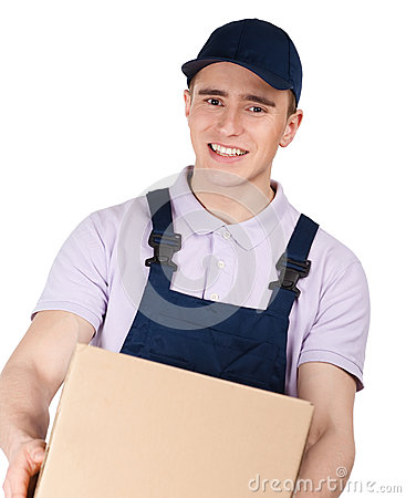 Workman in overalls keeps a parcel