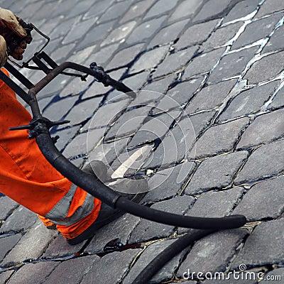 Workman repairing sidewalk