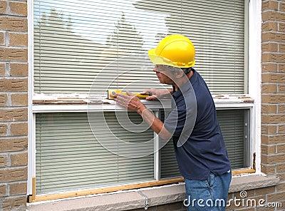 Workman repairing a window