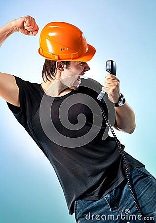 Workman screaming on phone