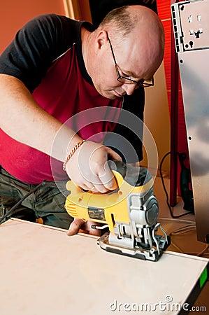 Workman using jigsaw