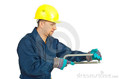 Workman working with saw