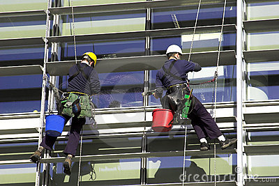 Workmen Abseiling A Corporate Building