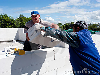 Workmen building wall