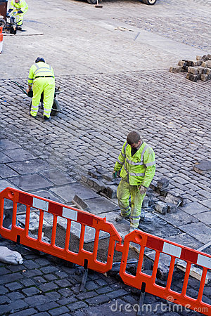 Workmen laying Cobbles