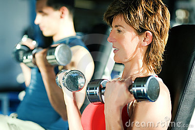 Workout with dumbbells in gym