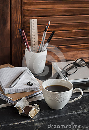 Free Workplace With Business Objects - Books, Notebooks, Pens, Tablet, Glasses And A Cup Of Coffee And Chocolate. Royalty Free Stock Photography - 64796307