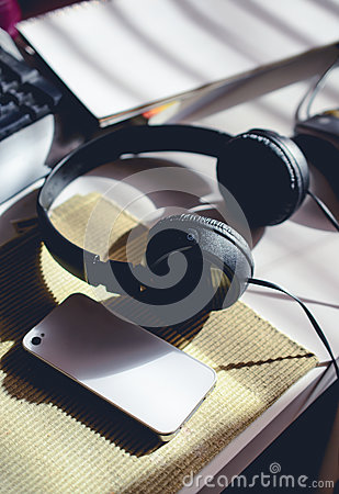 Free Workplace With Cell Phone, Head Phone, Keyboard And Blank Book W Royalty Free Stock Image - 79651366