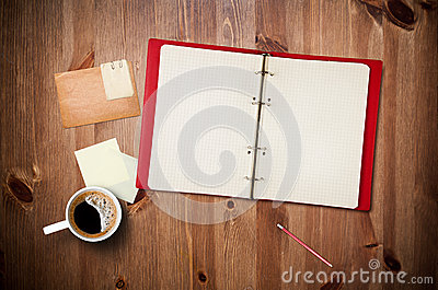 Workspace with coffee cup and notebook