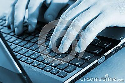 Workspace. Man typing
