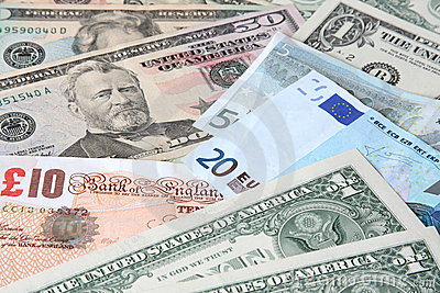 World currencies: U.S. dollars, pounds and euros.