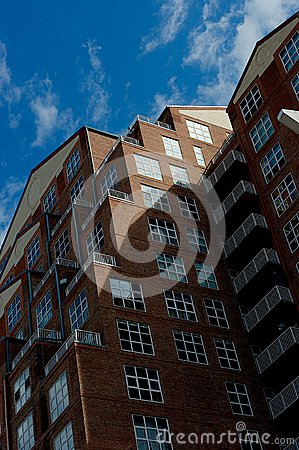 Worm's Eye View Of Brown Concrete Building Under Blue And White Cloudy Skies During Daytime Free Public Domain Cc0 Image
