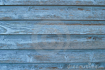 Worn blue board siding