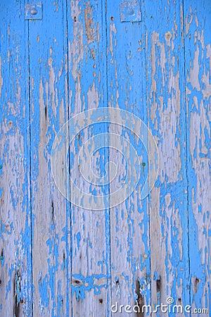 Worn Blue Wooden Door with Peeling Paint