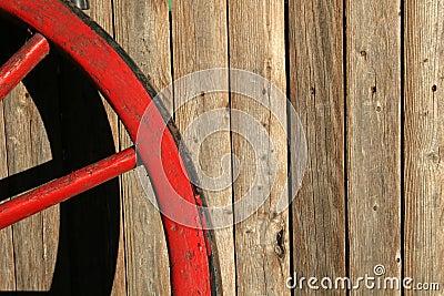 Worn Red Wagon Wheel