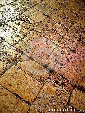 Worn stone floor