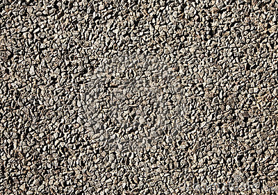Worn tarmac road surface.