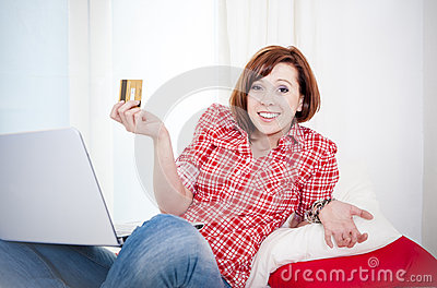Worreid red haired woman online shopping on white background