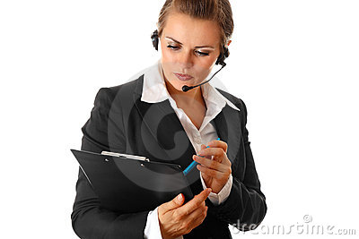 Worried business woman with headset and clipboard