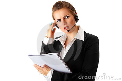 Worried  business woman with headset and notebook