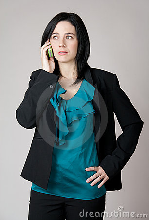 Worried business woman talking on the cell phone