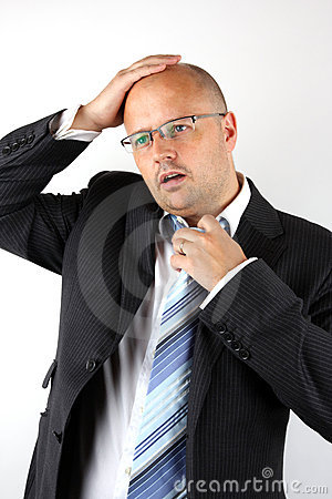 Worried Businessman Holding hi