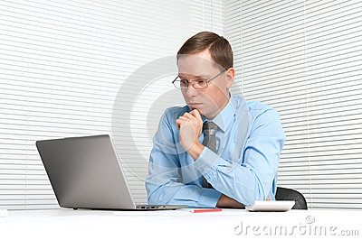 Worried businessman with laptop