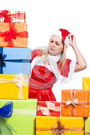 Worried Christmas woman looking at presents