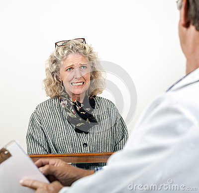 Worried Frightened Woman Talking with Her Doctor