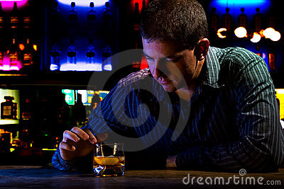 Worried man sitting at bar