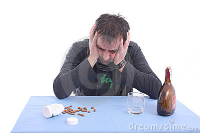 Worried man sitting at the table