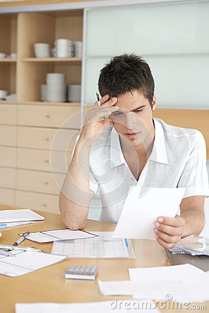 Worried Man Working on Finances