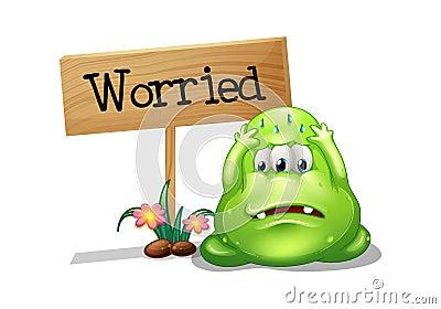 A worried monster beside the wooden signboard
