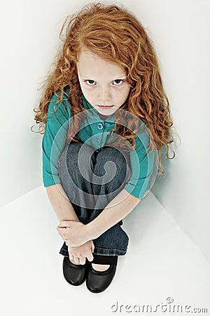 Worried Sad Girl Child in Sitting in Corner
