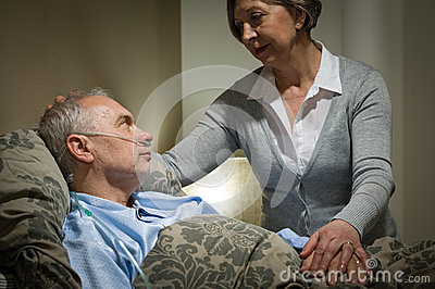 Worried senior woman caring with sick husband