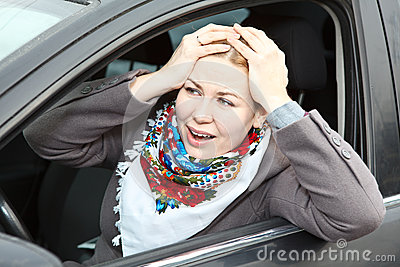 Worried woman in car
