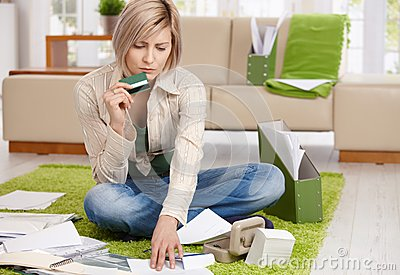 Worried woman checking documents