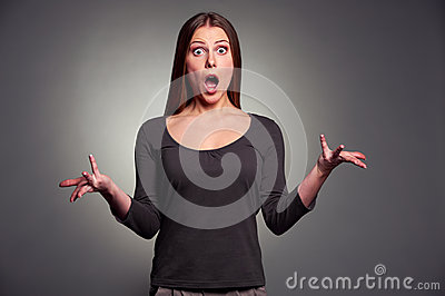 Worried woman over dark background