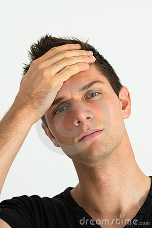 Worried young man with hand on head