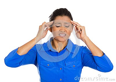 Worried young woman having really bad headache