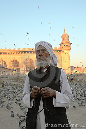 Worshiper and beads at Mecca Masjid mosque Editorial Stock Photo