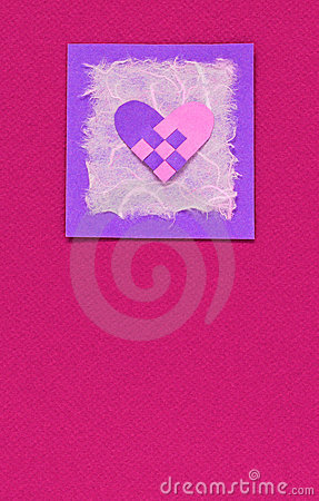 Woven heart on a pink background