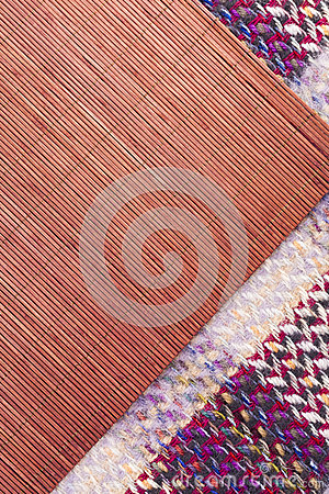 Woven picnic blanket and rafia placemat patterned background