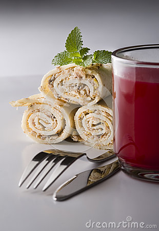 Wrapped pancakes and red borscht